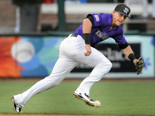 jt070215e/sports/jim thompson/Isotopes shortstop Trevor Story moves to reach the ball in Thursday night game against the Reno Aces. Thursday, July. 02, 2015.(Jim Thompson/Albuquerque Journal.)